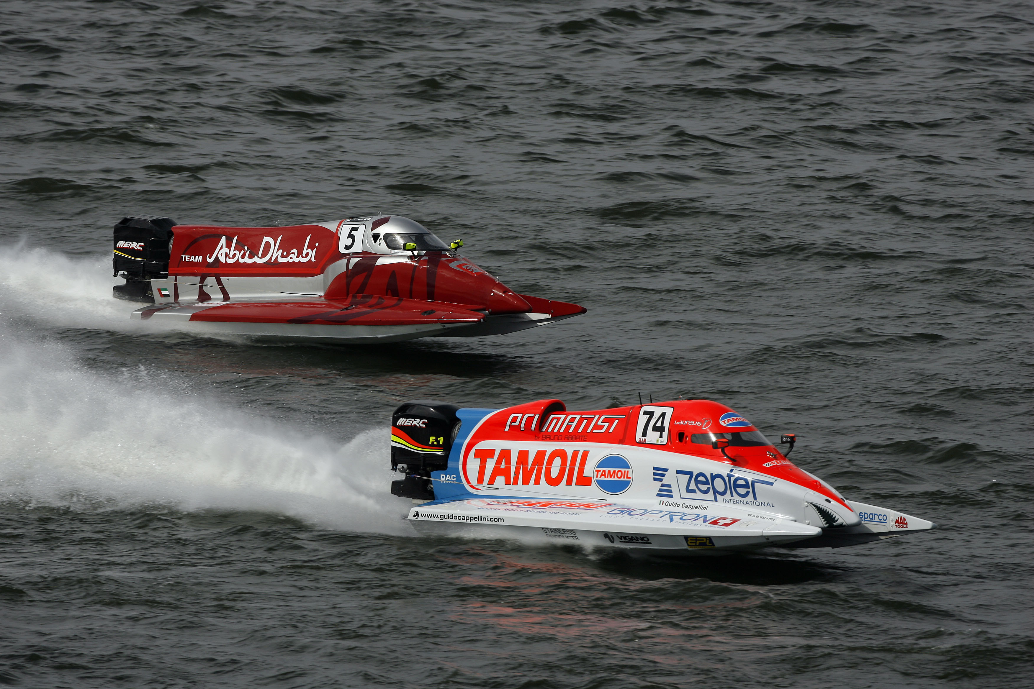 080608-GP OF FINLAND-Race winner Guido Cappellini of Italy of the Tamoil team and Al Qamzi Thani of UAE of the Team Abu Dhabi during the UIM F1 powerboat at the Grand Prix of Finland on Lake Lahti, June 8, 2008. Picture by Paul Lakatos/Idea Marketing.