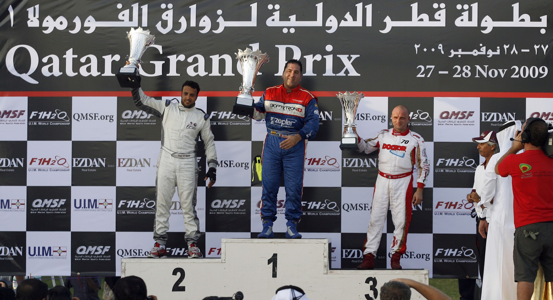 GP OF QATAR-271109-Podium of race one the UIM F1 Powerboat Grand Prix of Qatar, on the Doha Corniche, Doha, Qatar, the race days are November 27-28, 2009. From left to right, Al Thani Qamzi of UAE, 2nd place, Guido Cappellini of Italy, 1st place and Fabio Comparato of Italy in the 3rd place. Picture by Paul Lakatos/Idea Marketing.